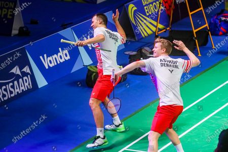 Kim Astrup (R) and Anders Skaarup Rasmussen (L) of Denmark celebrates after winning the men's doubles match against Ronan Labar and Julien Maio of France  for the final tie between Denmark and France final match at the Badminton European Mixed Team Championships in Vantaa, Finland, 20 February 2021.