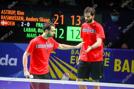 Ronan Labar (R) and Julien Maio (L) of France react during the men's doubles event against Kim Astrup and Anders Skaarup Rasmussen of Denmark for the final tie between Denmark and France final match at the Badminton European Mixed Team Championships in Vantaa, Finland, 20 February 2021.