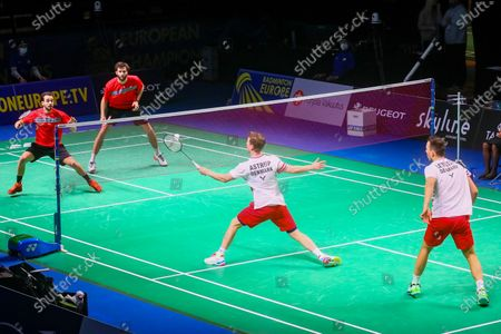 Kim Astrup (2R) and Anders Skaarup Rasmussen (R) of Denmark in action during the men's doubles event against Ronan Labar(2L) and Julien Maio(L) of France for the final tie between Denmark and France final match at the Badminton European Mixed Team Championships in Vantaa, Finland, 20 February 2021.