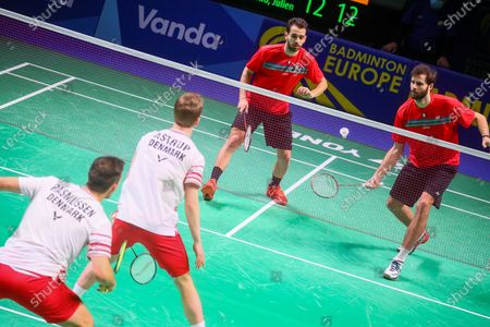 Ronan Labar (R) and Julien Maio (2R) of France in action during the men's doubles event against Kim Astrup (2L) and Anders Skaarup Rasmussen(L) of Denmark for the final tie between Denmark and France final match at the Badminton European Mixed Team Championships in Vantaa, Finland, 20 February 2021.