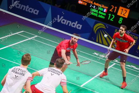 Kim Astrup (L) and Anders Skaarup Rasmussen (2L) of Denmark in action during the men's doubles event against Ronan Labar(2R) and Julien Maio(R) of France for the final tie between Denmark and France final match at the Badminton European Mixed Team Championships in Vantaa, Finland, 20 February 2021.