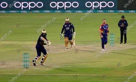 Chris Gayle (L) of Quetta Gladiators plays a shot during the opening match of the Pakistan Super League (PSL) T20 series cricket match between Karachi Kings and Quetta Gladiators in Karachi, Pakistan, 20 February 2021.