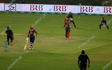 Karachi Kings batsmen Joe Clarke (C) plays a shot during the opening match of the Pakistan Super League (PSL) T20 series cricket match between Karachi Kings and Quetta Gladiators in Karachi, Pakistan, 20 February 2021.