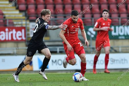 Leyton Orient Nick Freeman (28) runs wit the ball challenged by Tom Conlon (10) of Port Vale during the EFL Sky Bet League 2 match between Leyton Orient and Port Vale at the Breyer Group Stadium, London