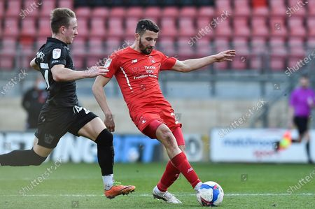 Leyton Orient Nick Freeman (28) passing the ball challenged by Alex Hurst (27) of Port Vale during the EFL Sky Bet League 2 match between Leyton Orient and Port Vale at the Breyer Group Stadium, London