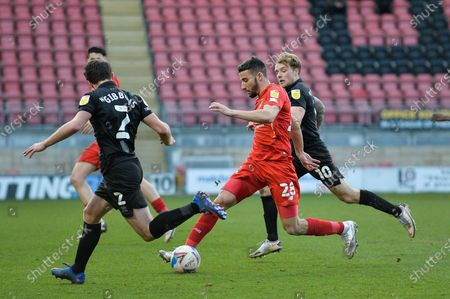 Leyton Orient Nick Freeman (28) takes on James Gibbons (2) of Port Vale during the EFL Sky Bet League 2 match between Leyton Orient and Port Vale at the Breyer Group Stadium, London