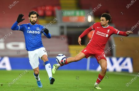 Everton's Andre Gomes, left vies for the ball with Liverpool's Trent Alexander-Arnold during the English Premier League soccer match between Liverpool and Everton at Anfield in Liverpool, England