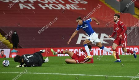 Liverpool's Trent Alexander-Arnold, (66) centre fouls Everton's Dominic Calvert-Lewin, for a penalty from which Everton's Gylfi Sigurdsson scored his sides second goal of the game during the English Premier League soccer match between Liverpool and Everton at Anfield in Liverpool, England, . (Phil Noble/ Pool via AP