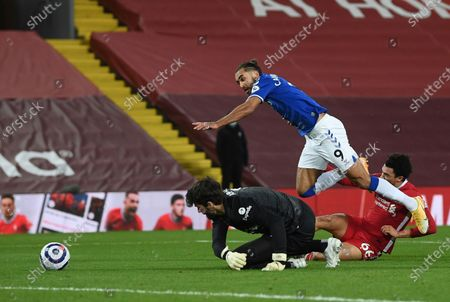 Liverpool's Trent Alexander-Arnold, (66) right, fouls Everton's Dominic Calvert-Lewin, for a penalty from which Everton's Gylfi Sigurdsson scored his sides second goal of the game during the English Premier League soccer match between Liverpool and Everton at Anfield in Liverpool, England, . (Phil Noble/ Pool via AP