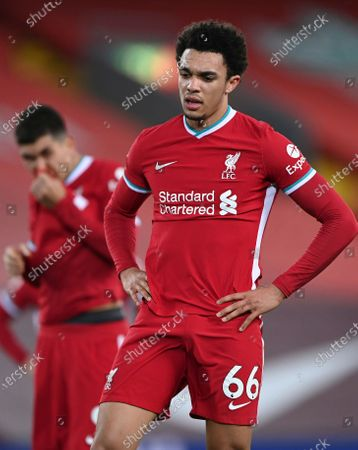 Liverpool's Trent Alexander-Arnold reacts after the end of the English Premier League soccer match between Liverpool and Everton at Anfield in Liverpool, England, . Everton won the game 2-0