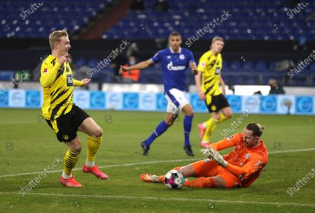 Stock Image of Julian Brandt (L) of Dortmund in action against Schalke's goalkeeper Ralf Faehrmann (R) during the German Bundesliga soccer match between FC Schalke 04 and Borussia Dortmund in Gelsenkirchen, Germany, 20 February 2021.
