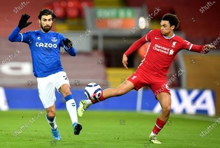 Liverpool's Trent Alexander-Arnold (R) in action against Andre Gomes (L) of Everton during the English Premier League soccer match between Liverpool FC and Everton FC in Liverpool, Britain, 20 February 2021.