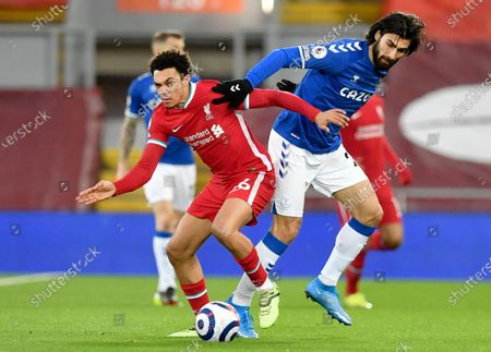 Liverpool's Trent Alexander-Arnold (L) in action against Andre Gomes (R) of Everton during the English Premier League soccer match between Liverpool FC and Everton FC in Liverpool, Britain, 20 February 2021.
