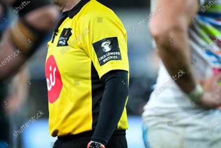 Stock Photo of Ospreys vs Zebre. Loch Lomond Whiskies branding on the sleeve of Referee Nigel Owens