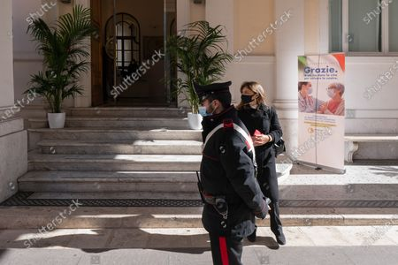 Carabinieri member and a guest are seen at the entrance. The National Federation of the Orders of Doctors and Dental Surgeons (FNOMCeO) celebrated the National Day of Healthcare Workers, Healthcare Members, Assistance Workers and Volunteers in Rome. The celebration is dedicated to the memory of doctors and dentists who died due to Covid-19 and it was going live at the Civic Hospital in Codogno and Berlin. Several authorities and celebrities like Maria Elisabetta Alberti Casellati, Italian Senate President; Roberto Fico, President of the Italian Chamber of Deputies and Roberto Speranza, Minister for Health, and the Turkish film director Ferzan Özpetek attended the event.