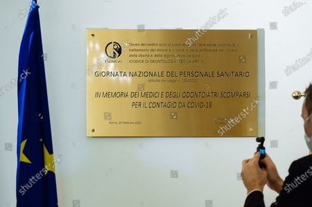 A commemorative Placard is being placed at the FNOMCeO's headquarter in Rome. The National Federation of the Orders of Doctors and Dental Surgeons (FNOMCeO) celebrated the National Day of Healthcare Workers, Healthcare Members, Assistance Workers and Volunteers in Rome. The celebration is dedicated to the memory of doctors and dentists who died due to Covid-19 and it was going live at the Civic Hospital in Codogno and Berlin. Several authorities and celebrities like Maria Elisabetta Alberti Casellati, Italian Senate President; Roberto Fico, President of the Italian Chamber of Deputies and Roberto Speranza, Minister for Health, and the Turkish film director Ferzan Özpetek attended the event.