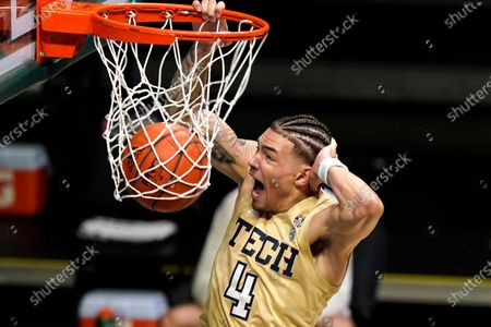 Georgia Tech guard Jordan Usher (4) dunks during the first half of an NCAA college basketball game against Miami, in Coral Gables, Fla