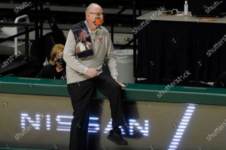 Stock Picture of Miami head coach Jim Larranaga watches during the second half of an NCAA college basketball game against Georgia Tech, in Coral Gables, Fla. Georgia Tech won 87-60. Larranaga is wearing a scarf with the likeness of former Georgetown basketball coach John Thompson Jr