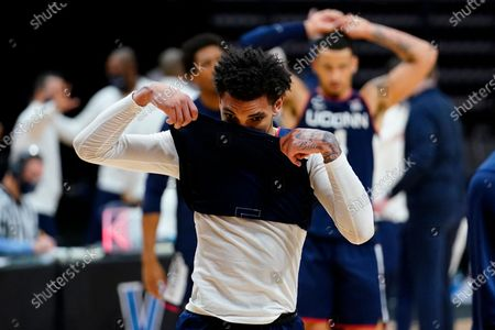 Connecticut's James Bouknight, left, and Tyrese Martin react after an NCAA college basketball game against Villanova, in Villanova, Pa