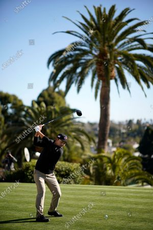 Sung Kang tees off on the first hole during the third round of the Genesis Invitational golf tournament at Riviera Country Club, in the Pacific Palisades area of Los Angeles
