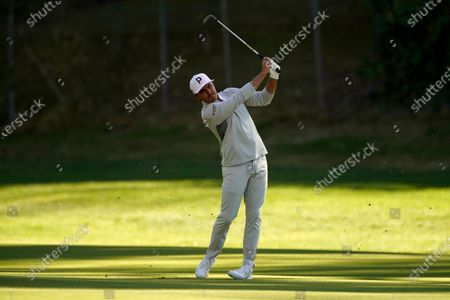Rickie Fowler hits his second shot on the 12th hole during the third round of the Genesis Invitational golf tournament at Riviera Country Club, in the Pacific Palisades area of Los Angeles