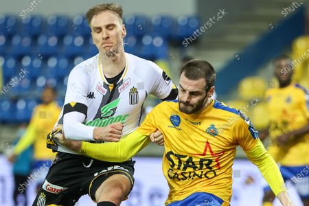 Waasland-Beveren's Aleksandar Vukotic and Charleroi's Lukasz Teodorczyk fight for the ball during a soccer match between Waasland-Beveren and Sporting Charleroi, Saturday 20 February 2021 in Beveren, on day 27 of the 'Jupiler Pro League' first division of the Belgian championship.