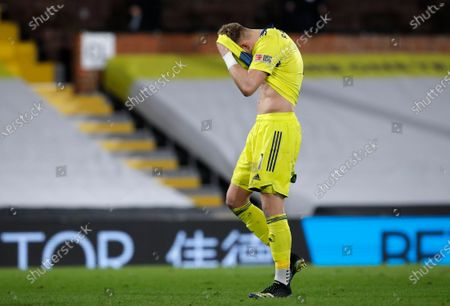 Sheffield United's goalkeeper Aaron Ramsdale reacts after the English Premier League soccer match between Fulham and Sheffield United at Craven Cottage in London, England, . Fulham won the match 1-0