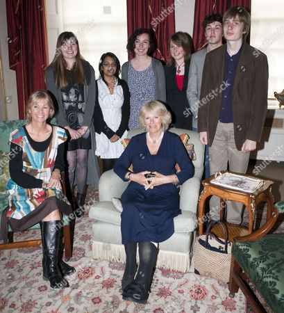 Camilla, Duchess of Cornwall meets with members of the Orange Prize Youth Panel (L-R) back row: Hazel Compton 19 from Norfolk, Pooja Gohil 17 from Bradford, Kate Edwards 17 from Glamorgan, Kirsty Woodford 17 from Cardiff, Fergus Ewbank 18 from York, Conrad Landin 17 from London and Kate Mosse (sitting) co-founder of the Orange prize