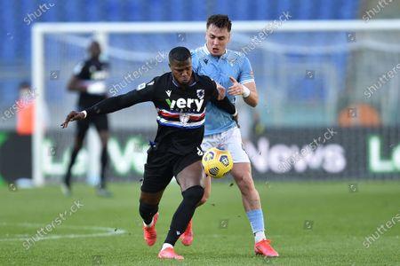 Balde Keita (R) of Sampdoria in action against Gabarron Gil (L) of Lazio