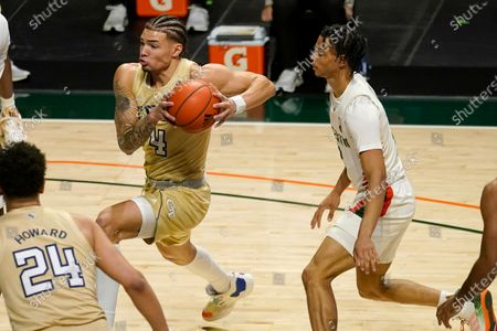 Georgia Tech guard Jordan Usher (4) as Miami guard Isaiah Wong (2) defends during the first half of an NCAA college basketball game, in Coral Gables, Fla