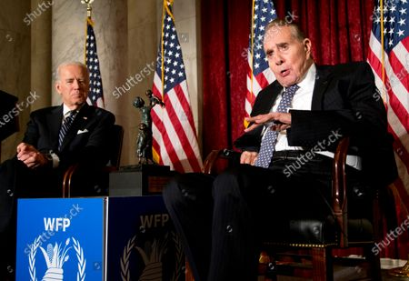 Stock Photo of Former Senate Majority Leader Bob Dole, right, speaks after being presented with the McGovern-Dole Leadership Award by Vice President Joe Biden, left, to honor his leadership in the fight against hunger, during the 12th Annual George McGovern Leadership Award Ceremony hosted by World Food Program USA, on Capitol Hill in Washington. President Biden is paying a visit to Dole, days after the former GOP presidential contender and World War II veteran announced he'd been diagnosed with stage 4 lung cancer