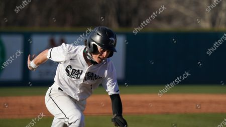 Upstate outfielder Jack Hennessy runs home during an NCAA baseball game against Toledo, in Spartanburg, S.C. USC Upstate won 14-2
