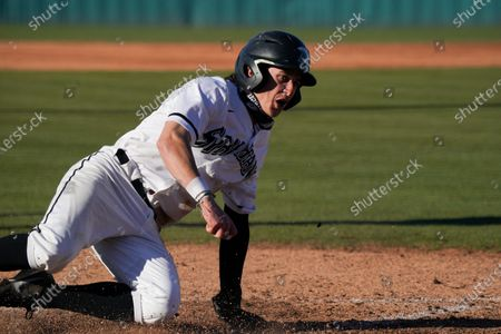 Stock Picture of Upstate outfielder Jack Hennessy slides into home during an NCAA baseball game against Toledo, in Spartanburg, S.C. USC Upstate won 14-2