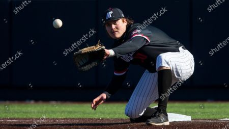 Stock Image of Austin Peavy first baseman John McDonald (10) catches the throw to force out Dallas Baptist Ryan Wrobleski (7) in the third inning during an NCAA baseball game, in Dallas