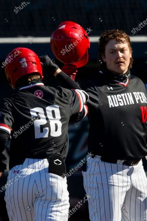Austin Peavy's Garrett Spain (28) is congratulated by John McDonald (10) after hitting a solo home run in the fourth inning during an NCAA baseball game against Dallas Baptist, in Dallas