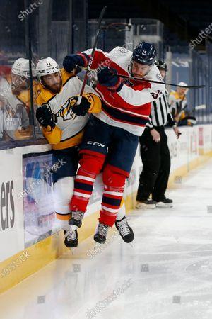 Columbus Blue Jackets' Michael Del Zotto, right, checks Nashville Predators' Luke Kunin during the first period of an NHL hockey game, in Columbus, Ohio