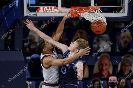 Gonzaga guard Aaron Cook, left, dunks over San Diego forward Ben Pyle during the second half of an NCAA college basketball game in Spokane, Wash