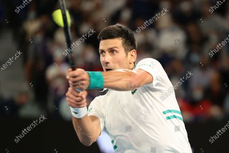 1st seed Novak Djokovic of Serbia in action against 4th seed Daniil Medvedev of the Russian Federation in the Men's Final match match on day 14 of the Australian Open on Rod Laver Arena, in Melbourne, Australia