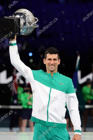 Stock Image of 1st seed Novak Djokovic of Serbia celebrates after defeating 4th seed Daniil Medvedev of the Russian Federation in the Men's Final match match on day 14 of the Australian Open on Rod Laver Arena, in Melbourne, Australia