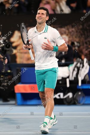 Stock Photo of 1st seed Novak Djokovic of Serbia celebrates after defeating 4th seed Daniil Medvedev of the Russian Federation in the Men's Final match match on day 14 of the Australian Open on Rod Laver Arena, in Melbourne, Australia