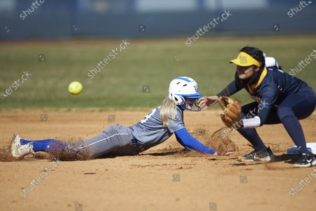 Emily Brown (19) of the Georgia State Panthers dives back towards second base as Alyxx Estrada (3) of the NC A&T Aggies waits for the throw during an NCAA softball game, in Greensboro, N.C