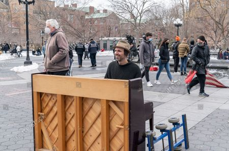 Editorial photo of Street musician Andrew Kalleen plays piano, New York, United States - 20 Feb 2021