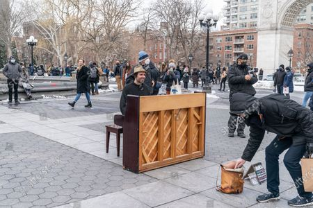 Editorial picture of Street musician Andrew Kalleen plays piano, New York, United States - 20 Feb 2021