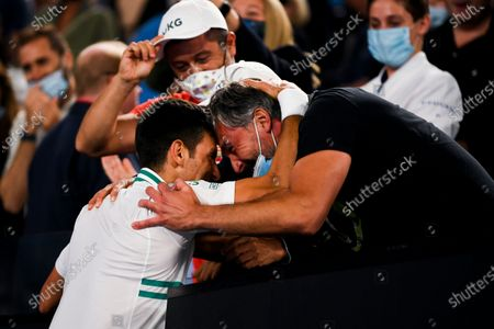 Novak Djokovic of Serbia is congratulated by coach Goran Ivanisevic after winning his Men's singles finals match against Daniil Medvedev of Russia on Day 14 of the Australian Open Grand Slam tennis tournament at Melbourne Park in Melbourne, Australia, 21 February 2021.
