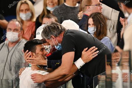 Stock Picture of Novak Djokovic of Serbia is congratulated by coach Goran Ivanisevic after winning his Men's singles finals match against Daniil Medvedev of Russia on Day 14 of the Australian Open Grand Slam tennis tournament at Melbourne Park in Melbourne, Australia, 21 February 2021.