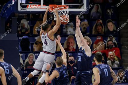 Gonzaga guard Aaron Cook (4) dunks while pressured by San Diego guard Joey Calcaterra (2) and forward Ben Pyle (33) during the second half of an NCAA college basketball game in Spokane, Wash