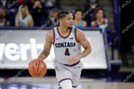 Gonzaga guard Aaron Cook brings the ball up the court during the first half of an NCAA college basketball game against San Diego in Spokane, Wash