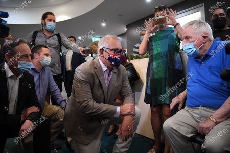 Australian Prime Minister Scott Morrison (C) speaks with Aged care resident John Healy (R) ahead of him receiving the second Covid-19 vaccine in Australia during a visit to Castle Hill Medical Centre to preview the COVID-19 vaccination program, in Sydney, Australia, 21 February 2021.