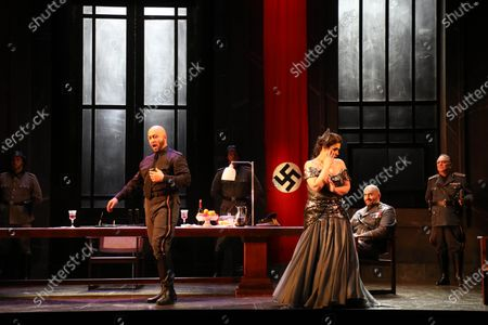 Stock Photo of Marco Vratogna in the role of Scarpia and Carmen Giannattasio in the role of Tosca.