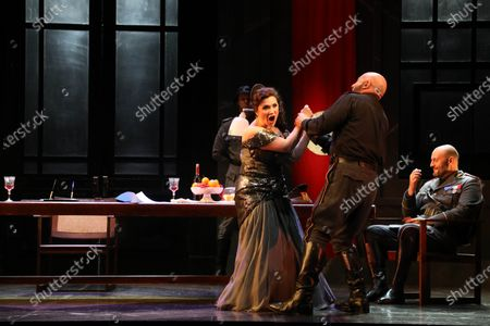 Stock Picture of Marco Vratogna in the role of Scarpia and Carmen Giannattasio in the role of Tosca.